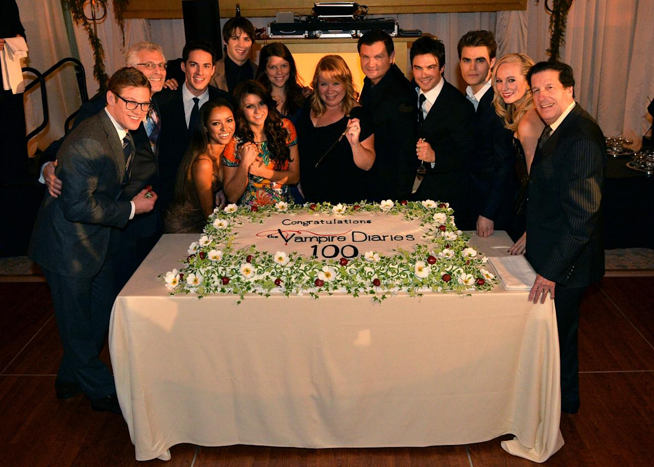 ATLANTA, GA - NOVEMBER 09: (L-R) Zach Roerig, Mark Pedowitz, Michael Trevino, Kat Graham, Steven R. McQueen, Nina Dobrev, Caroline Dries, Julie Plec, Kevin Williamson, Ian Somerhalder, Paul Wesley, Candice Accola, and Peter Roth attend The Vampire Diaries 100th Episode Celebration on November 9, 2013 in Atlanta, Georgia. (Photo by Rick Diamond/Getty Images for Warner Bros)