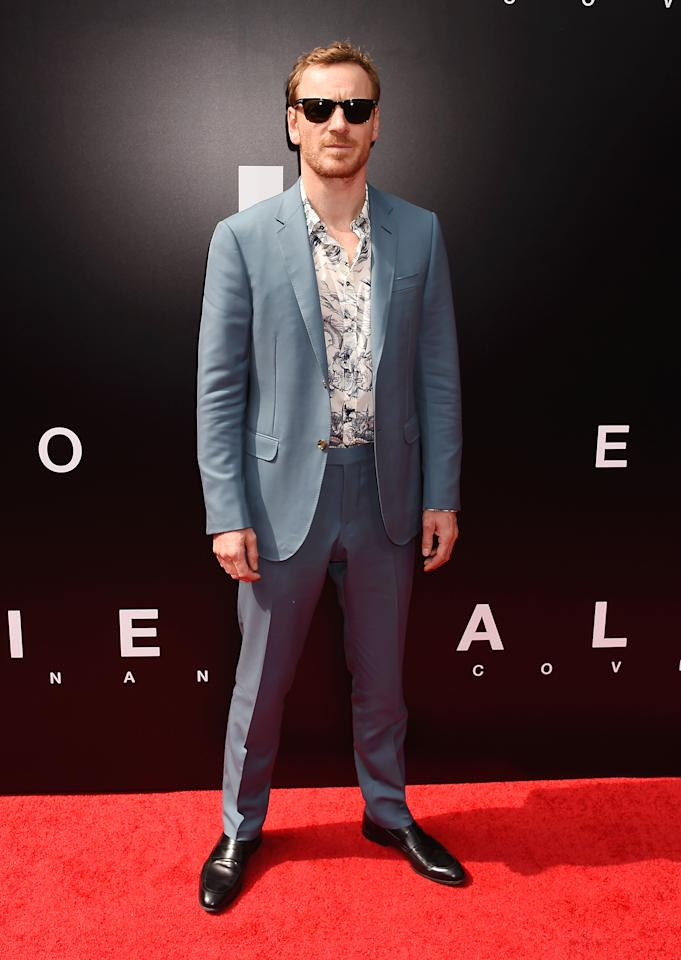 <p>Michael Fassbender is just too cool for school. The recently married actor can kill anything from a good tee and jeans to a floral shirt and blue suit combo. <i>[Photo: Getty]</i> </p>