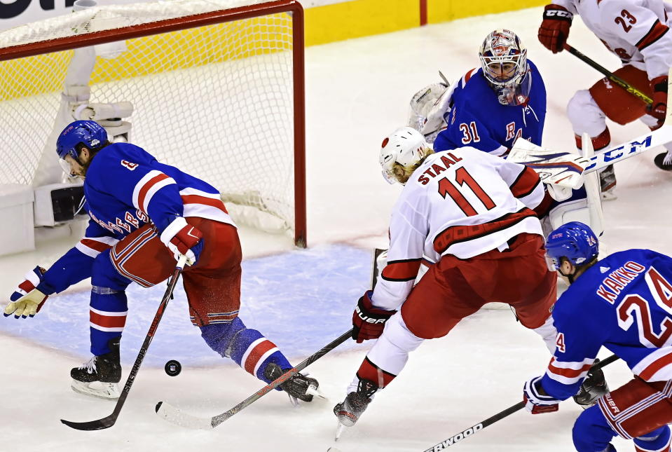 Carolina Hurricanes' Jordan Staal (11) tries to get a shot through New York Rangers' Jacob Trouba (8) and goaltender Igor Shesterkin (31) during second period NHL Eastern Conference Stanley Cup playoff action in Toronto on Tuesday, Aug. 4, 2020. (Frank Gunn/The Canadian Press via AP)