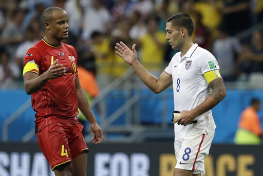 Belgium's Vincent Kompany, left, greets United States' Clint Dempsey after the World Cup round of 16 soccer match between Belgium and the USA at the Arena Fonte Nova in Salvador, Brazil, Tuesday, July 1, 2014. Belgium won the match 2-1 after extra-time. (AP Photo/Matt Dunham)