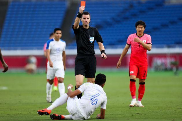 With zero fan pressure, referee Kabakov Georgi gives a red card to Carlos Melendez of Honduras during the men's Group B match at the Tokyo Games on July 28, 2021. (Photo: Zhizhao Wu via Getty Images)