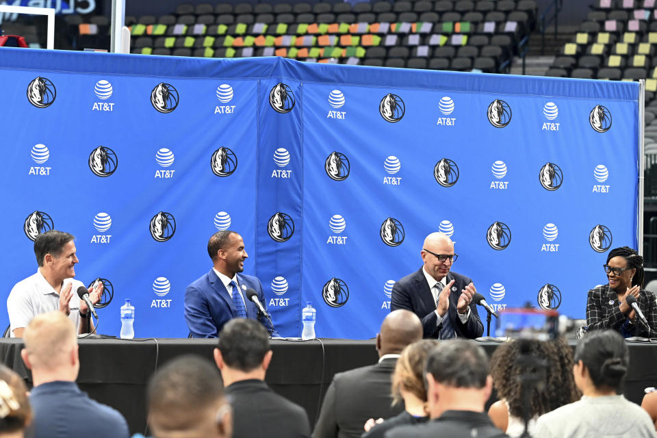 From left, Dallas Mavericks NBA basketball team owner Mark Cuban, new general manager Nico Harrison, new head coach Jason Kidd and Cynt Marshall, CEO, reacts during a press conference formally introducing Kidd and Harrison, Thursday, July 15, 2021, in Dallas. (AP Photo/Matt Strasen)