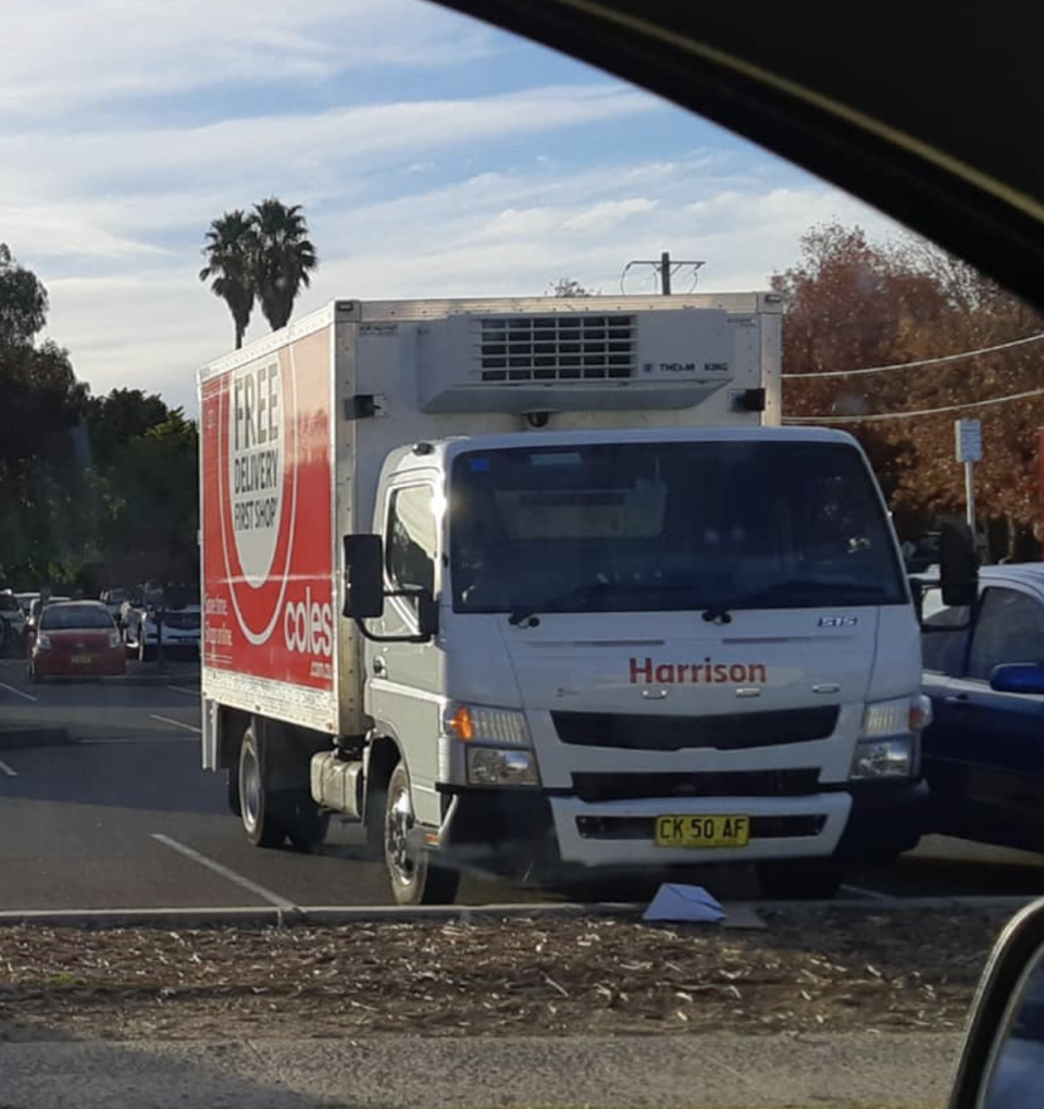 A Coles delivery truck shown after Tasmanian family have groceries taken away.