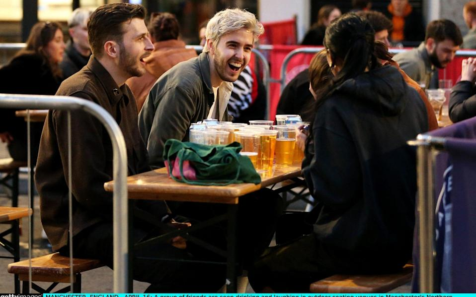 A group of friends are seen drinking and laughing in outdoor seating venues in Manchester's Northern Quarter on April 16 - Charlotte Tattersall/Getty Images Europe
