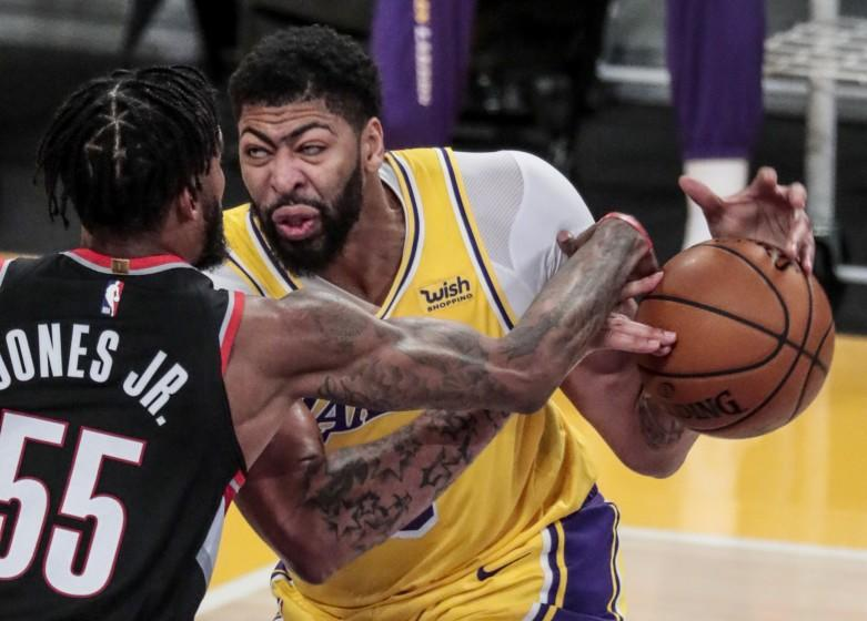 Los Angeles, CA, Monday, December 28, 2020 - Portland Trail Blazers forward Derrick Jones Jr. (55) strips the ball from Los Angeles Lakers forward Anthony Davis (3) during second half action at Staples Center. (Robert Gauthier/ Los Angeles Times)