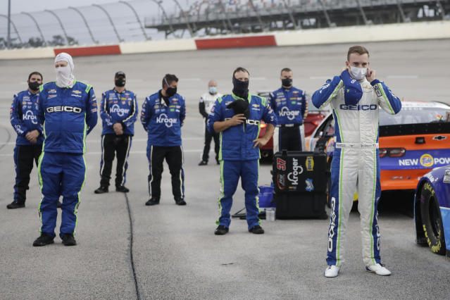 Driver Ty Dillon, right, stands for the national anthem before the start of the Toyota 500 NASCAR Cup Series auto race Wednesday, May 20, 2020, in Darlington, Tenn. (AP Photo/Brynn Anderson)