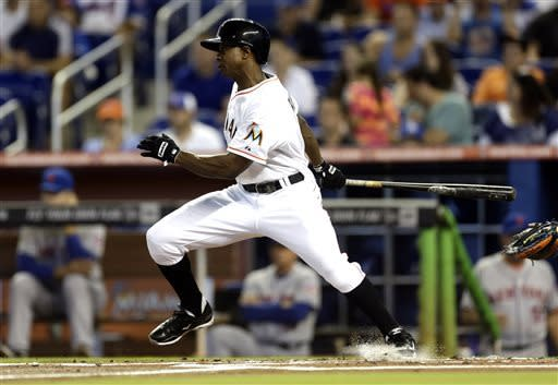 Miami Marlins' Juan Pierre grounds out against the New York Mets during the first inning of a baseball game in Miami, Saturday, June 1, 2013. (AP Photo/J Pat Carter)