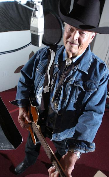 """In a Dec. 17, 2007 photo Claude King works on his latest album he is recording at the Red River Studio in Shreveport, La. Country singer-songwriter Claude King, an original member of the Louisiana Hayride who was best known for the 1962 hit """"Wolverton Mountain,"""" has died. He was 90. (AP Photo/Douglas Collier/The (Shreveport) Times) (AP Photo/The Shreveport Times,Douglas Collier ) MAGS OUT; MANDATORY CREDIT SHREVEPORTTIMES.COM; NO SALES"""