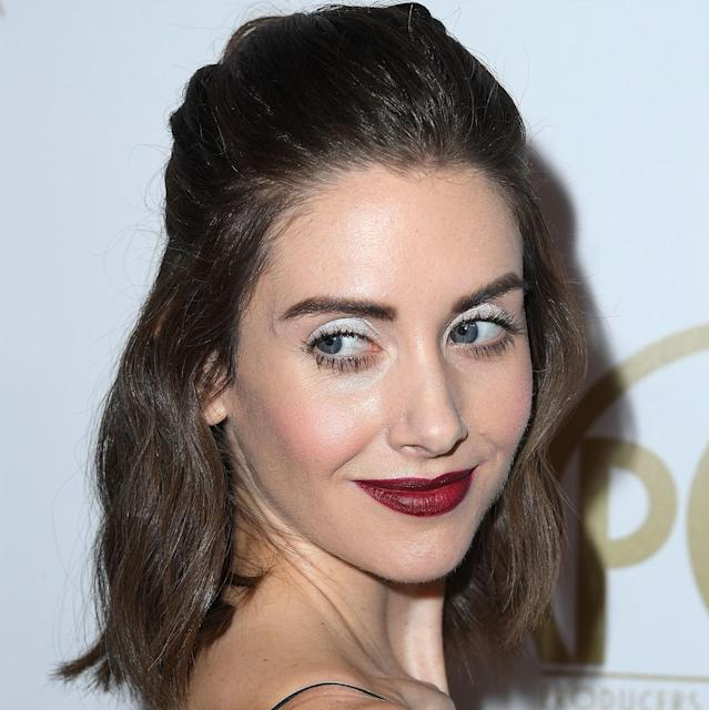 "Makeup artist Mai Quynh created a stunning contrast for Alison Brie's Producers Guild Awards look by going with a super-light color on her lids (<a href=""https://jillstuartbeautyusa.com/collections/eyes/products/iconic-look-eyeshadow?variant=21578690822262"" rel=""nofollow noopener"" target=""_blank"" data-ylk=""slk:Jill Stuart Beauty Iconic Look Eyeshadow"" class=""link rapid-noclick-resp"">Jill Stuart Beauty Iconic Look Eyeshadow</a> in C201) and a super-dark color on her lips (<a href=""https://shop-links.co/1662160305920148085"" rel=""nofollow noopener"" target=""_blank"" data-ylk=""slk:Chanel Rouge Allure Velvet Extreme"" class=""link rapid-noclick-resp"">Chanel Rouge Allure Velvet Extreme</a> lipstick in 116). But the most exciting part of the look may very well be what you don't even notice: Brie is wearing the brand-new <a href=""https://www.allure.com/story/fenty-beauty-concealer-review-shades-swatches?mbid=synd_yahoo_rss"" rel=""nofollow noopener"" target=""_blank"" data-ylk=""slk:Fenty Beauty Pro Filt'r Concealer"" class=""link rapid-noclick-resp"">Fenty Beauty Pro Filt'r Concealer</a> in shade 140."