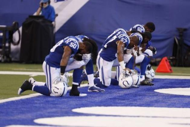 A group of Colts players kneel during the anthem. (Reuters)