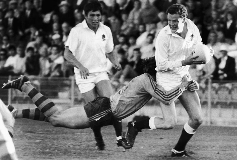 FILE - In this May 23, 1987 file photo, England's full-back Jon Webb, right, is tackled by Australia's full-back Roger Gould during the Rugby World Cup Group 1 match between Australia and England at the the Concord Oval, Sydney. England will play Australia in the 2019 Rugby World Cup quarterfinal match on Saturday Oct. 18, 2019. (AP Photo/File)