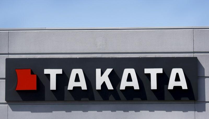 A sign with the Takata logo is seen outside the Takata Corporation building in Auburn Hills, Michigan
