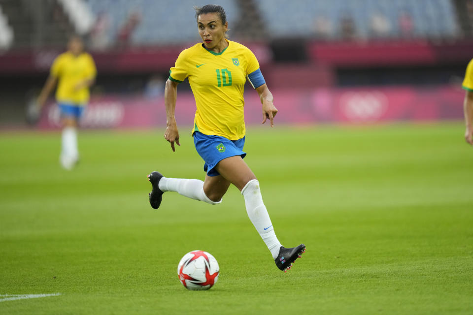 Brazil's Marta dribbles the ball during a women's soccer match against China at the 2020 Summer Olympics, Wednesday, July 21, 2021, in Rifu, Japan. (AP Photo/Andre Penner)