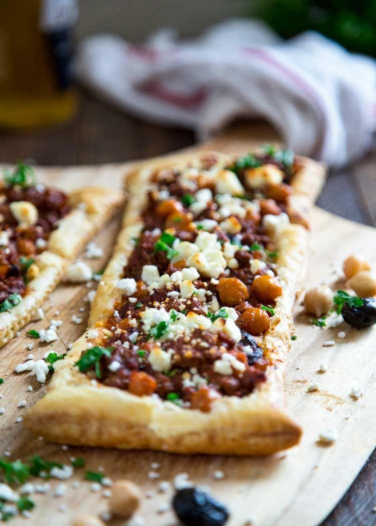 """<p>It doesn't get prettier than this. This is one of those meals that comes together in 30 minutes, and the result is pretty darn amazing. </p><p>Get the <a href=""""https://keviniscooking.com/greek-lamb-chickpea-and-feta-tart/"""" rel=""""nofollow noopener"""" target=""""_blank"""" data-ylk=""""slk:Greek Lamb Feta Tart"""" class=""""link rapid-noclick-resp"""">Greek Lamb Feta Tart</a> recipe. </p><p>Recipe from <a href=""""https://keviniscooking.com/"""" rel=""""nofollow noopener"""" target=""""_blank"""" data-ylk=""""slk:Kevin Is Cooking"""" class=""""link rapid-noclick-resp"""">Kevin Is Cooking</a>. </p>"""