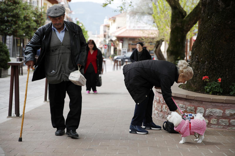In this Tuesday, May 14, 2019, photo, a man uses his walking stick in Karpenisi town at Evrytania region, in central Greece. As balloting for the European Parliament gets underway Thursday and continues through Sunday voters over 55 are emerging as a powerful bloc on a rapidly aging continent as younger voters stay away from the polls in growing numbers. (AP Photo/Thanassis Stavrakis)