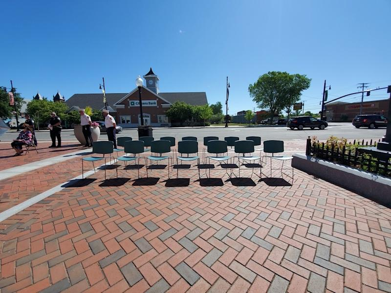 City officials participate in a national day of mourning at Nashua City Hall June 1, including 14 empty chairs to acknowledge Gate City residents who have died.
