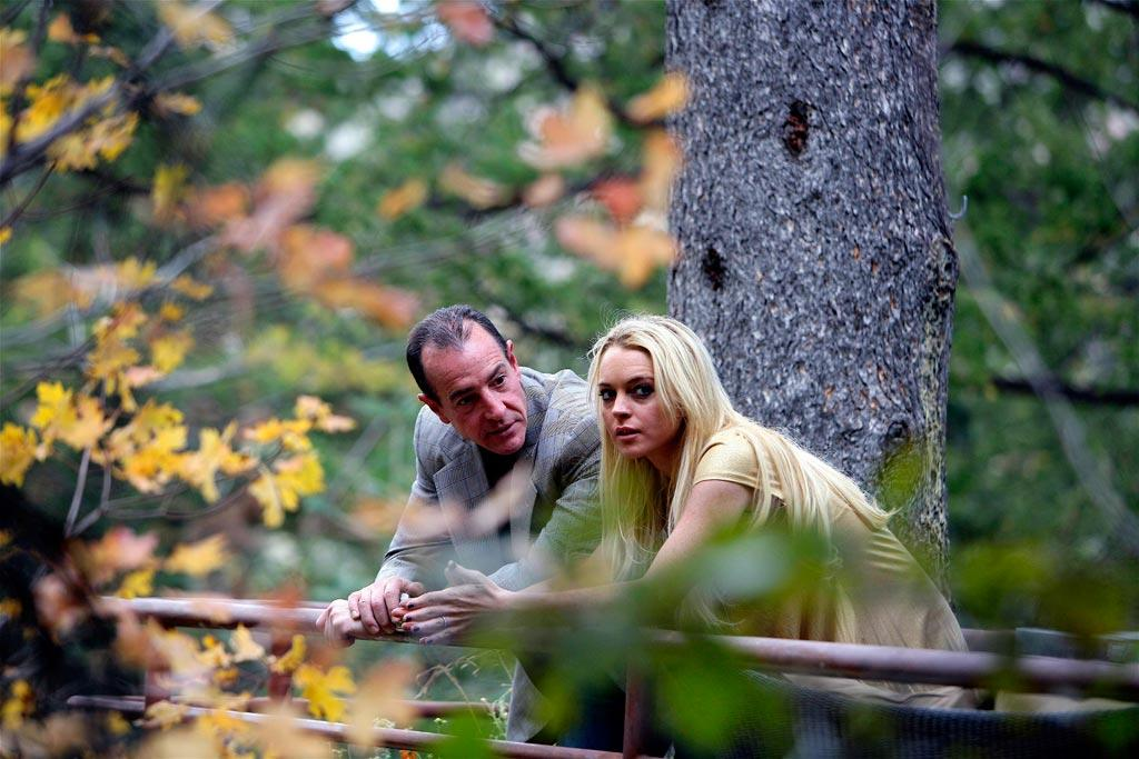 "While in rehab, Lindsay was spotted having a private conversation with her estranged father, Michael Lohan, whom she hadn't seen in three years. Although Michael continues to pretend he's concerned for his daughter, he has a funny way of showing it. After Lindsay was sentenced to 90 days in jail this past July 6, Michael headed to the Saddle Ranch bar and grill on the Sunset Strip, where he posed for photos with ""fans."" AlphaX/<a href=""http://www.x17online.com"" target=""new"">X17 Online</a> - October 5, 2007"