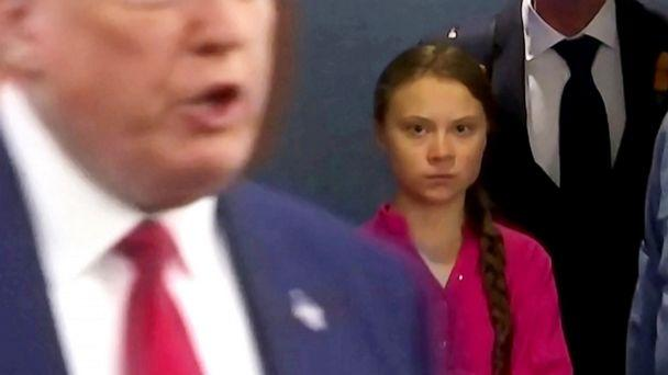 PHOTO: Swedish environmental activist Greta Thunberg watches as President Donald Trump enters the United Nations to speak with reporters in a still image from video taken in New York, Sept. 23, 2019. (Andrew Hofstetter/Reuters)