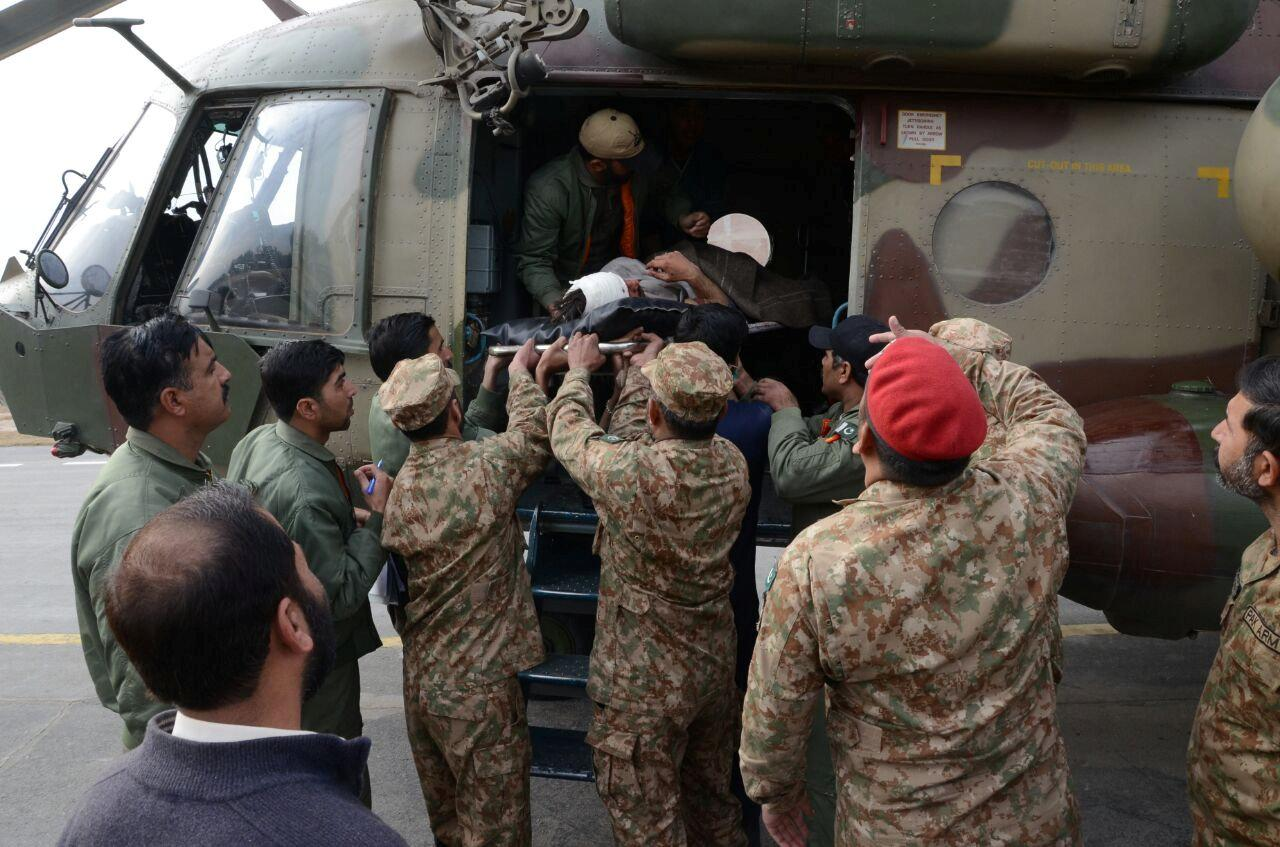 In this picture released on the website of Pakistan Inter Services Public Pelations (ISPR), Pakistani army officials carry a wounded man, victim of a bomb blast in Parachinar, after he was brought by a helicopter for treatment in Peshawar, Pakistan, January 21, 2017. Pakistan Inter Services Public Relations (ISPR)/Handout via REUTERS. ATTENTION EDITORS - THIS IMAGE WAS PROVIDED BY A THIRD PARTY. EDITORIAL USE ONLY. NO RESALES. NO ARCHIVE