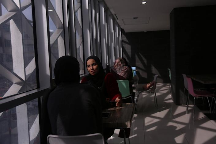 Palestinian women wait for their order at a food court in a mall in Gaza City on Nov. 28, 2018. (Photo: Samar Abo Elouf/Reuters)
