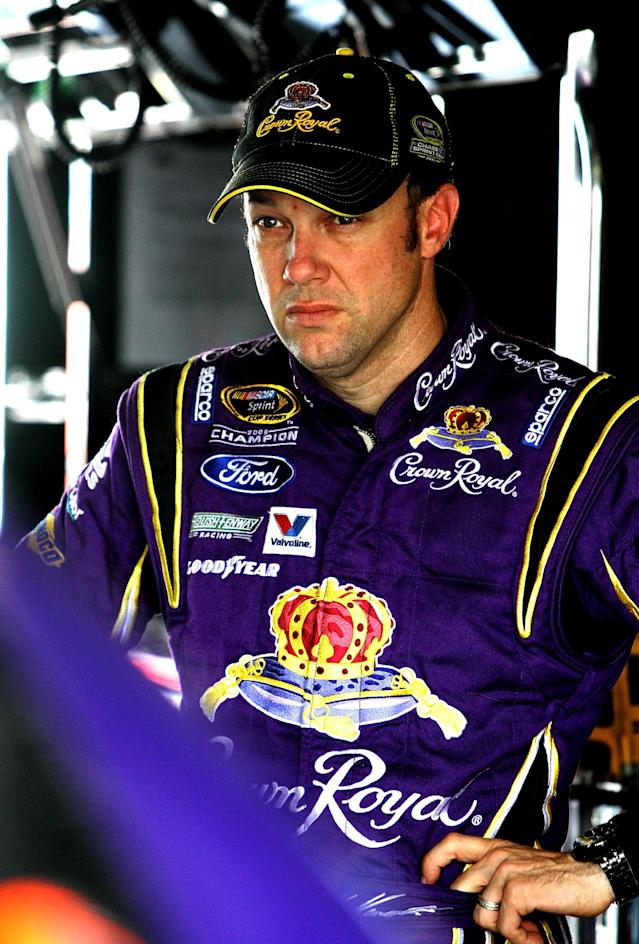 HOMESTEAD, FL - NOVEMBER 19: Matt Kenseth, driver of the #17 Crown Royal Ford, stands in the garage area during practice for the NASCAR Sprint Cup Series Ford 400 at Homestead-Miami Speedway on November 19, 2011 in Homestead, Florida. (Photo by Jerry Markland/Getty Images for NASCAR)