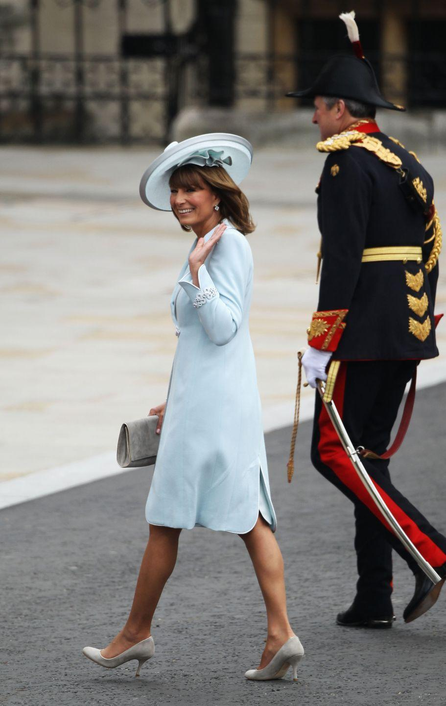 <p>The mother-of-the-bride, Carole Middleton, looks radiant in a dove blue hat.</p>