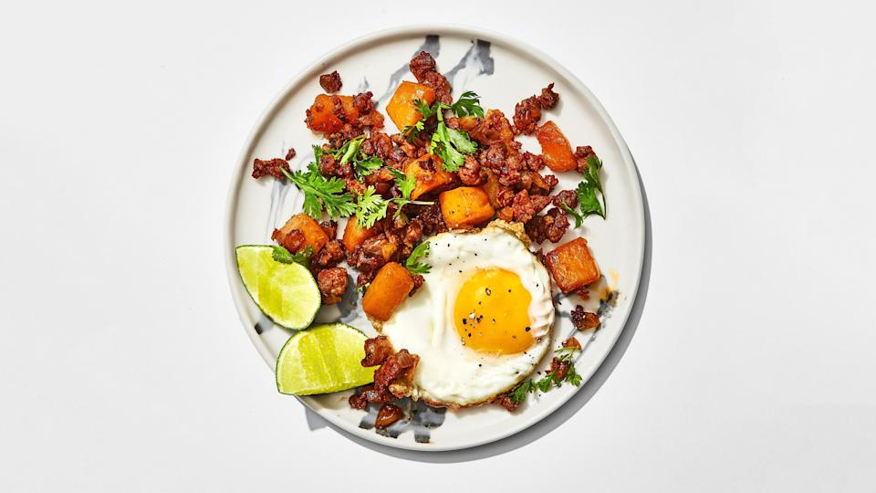 "Top this sweet and spicy hash recipe with eggs for breakfast or fold it into tortillas for a taco with some sour cream and hot sauce on top and you've got dinner. <a href=""https://www.bonappetit.com/recipe/butternut-squash-and-chorizo-hash?mbid=synd_yahoo_rss"" rel=""nofollow noopener"" target=""_blank"" data-ylk=""slk:See recipe."" class=""link rapid-noclick-resp"">See recipe.</a>"