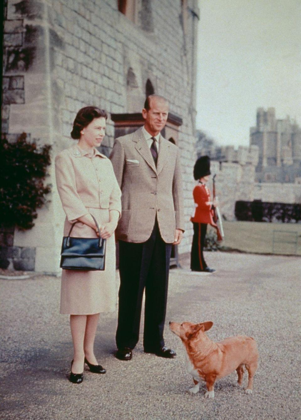 <p>Queen Elizabeth II and Prince Philip with one of their beloved corgis at Windsor Castle in Berkshire, pictured in 1959. </p>