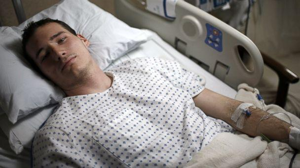 PHOTO: Virginia Tech student Colin Goddard lies in his hospital bed on April 19, 2007 in Blacksburg, Va. (Charles Ommanney/Getty Images)