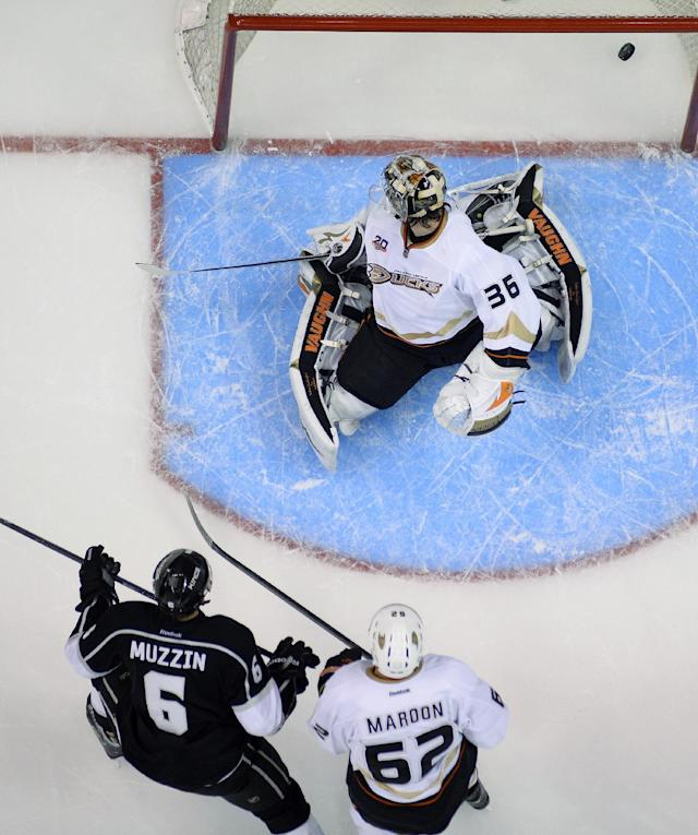 Los Angeles Kings defenseman Jake Muzzin, lower left, scores as Anaheim Ducks left wing Patrick Maroon, lower right, and goalie John Gibson look on during the first period in Game 6 of an NHL hockey second-round Stanley Cup playoff series, Wednesday, May 14, 2014, in Los Angeles. (AP Photo)