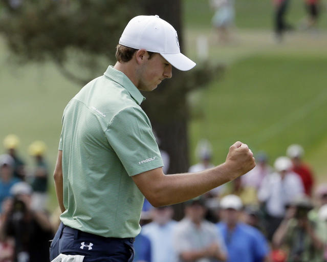 Jordan Spieth reacts to his birdie on the seventh green during the fourth round of the Masters golf tournament Sunday, April 13, 2014, in Augusta, Ga. (AP Photo/Chris Carlson)