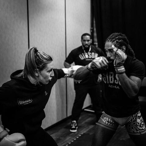Julia Budd in the dressing room with team-mates - Credit: Will Fox/Bellator