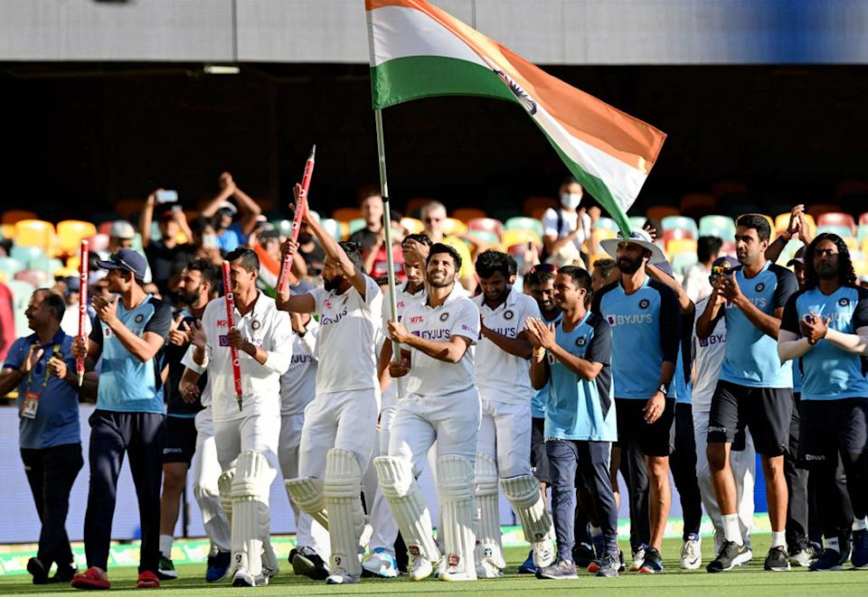 """<div class=""""paragraphs""""><p>Indian team takes the victory lap around the Gabba.</p></div>"""
