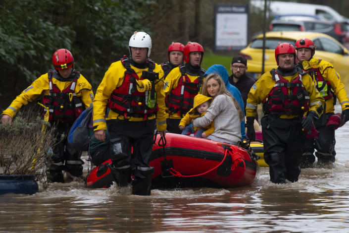 A family are rescued from a property on Oxford Street in Nantgarw, Wales. (Getty Images)