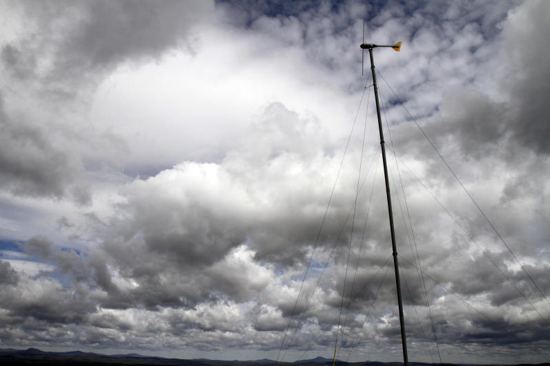 The wind turbine owned by Bryan Davis stands on the hilltop on Friday, May 11, 2012 in Derby Line, Vt. A Vermont wind power developer and two dairy farmers in the border community of Derby Line say they've been surprised at the level of opposition to a plan to build two turbines that has been coming from the Quebec town of Stanstead.(AP Photo/Toby Talbot)