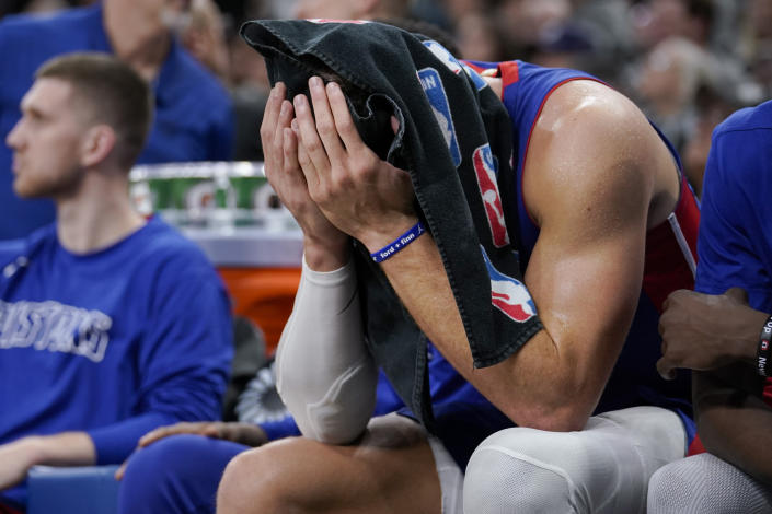 Detroit Pistons forward Blake Griffin sits on the bench during the second half of the team's NBA basketball game against the San Antonio Spurs, Saturday, Dec. 28, 2019, in San Antonio. San Antonio won 136-109. (AP Photo/Darren Abate)