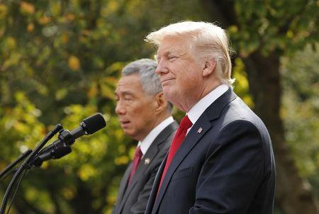 Singapore's Prime Minister Lee Hsien Loong and U.S. President Donald Trump give joint statements in the Rose Garden of the White House in Washington, U.S., October 23, 2017. REUTERS/Jonathan Ernst