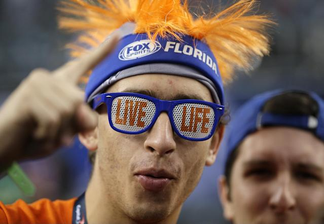 A Florida fan reacts before an NCAA Final Four tournament college basketball semifinal game against Connecticut, Saturday, April 5, 2014, in Arlington, Texas. (AP Photo/David J. Phillip)