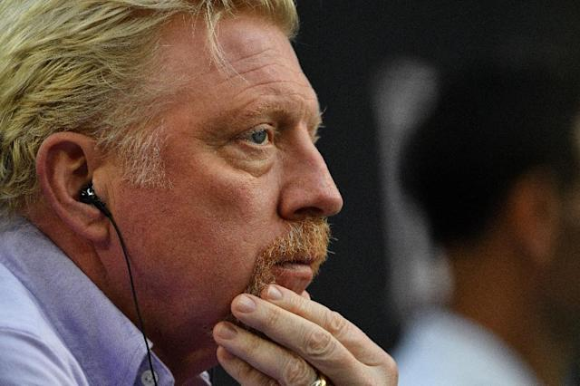 Tennis great Boris Becker has dropped his claim of diplomatic immunity linkd to his role as a sporting ambassador for the Central African Republic from bankruptcy proceedings (AFP Photo/SAEED KHAN)