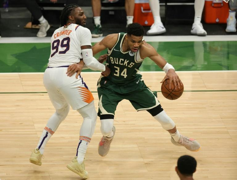 Milwaukee's Giannis Antetokounmpo, right, drives to the basket against Phoenix's Jae Crowder in Sunday's game three of the NBA Finals