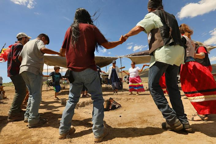 Members of the Fort McDermitt Paiute and Shoshone Tribe and supporters take part in a circle dance.
