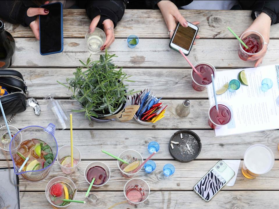<p>Reading the signals: Changes in friends' socialising habits or their ability to share costs may be symptoms of economic abuse</p> (AFP via Getty Images)
