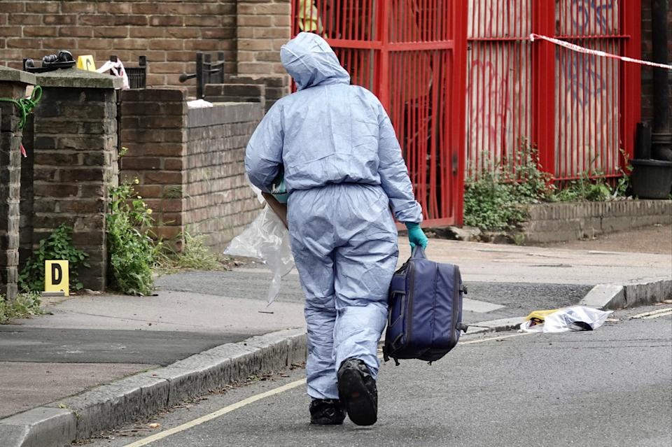A forensic officer at the scene in Peckham todayJeremy Selwyn