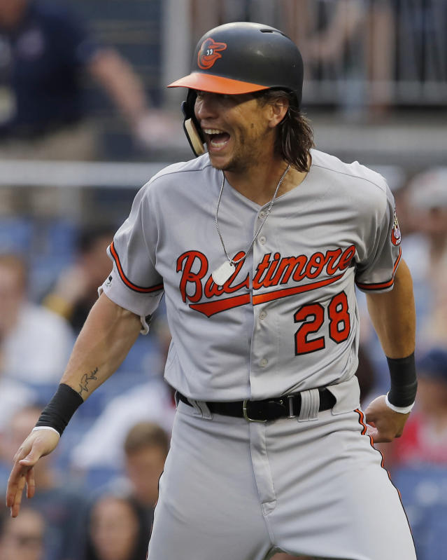 Baltimore Orioles' Colby Rasmus celebrates his solo home run during the second inning of the team's baseball game against the Washington Nationals at Nationals Park, Thursday, June 21, 2018, in Washington. (AP Photo/Carolyn Kaster)