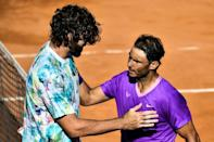 Nadal (R) ended the run of American Reilly Opelka (L) in Rome