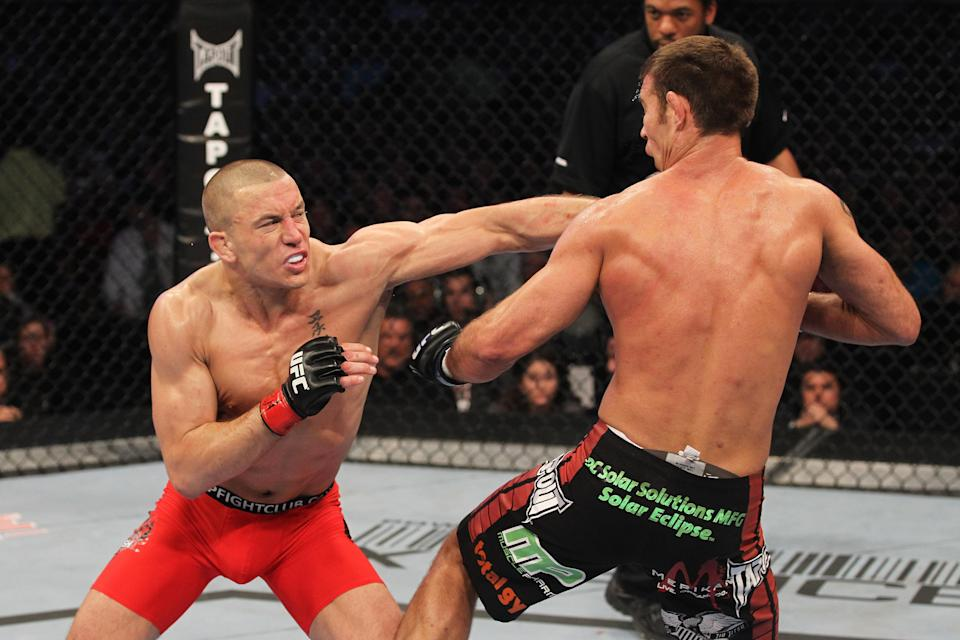 Georges St-Pierre (L) and Jake Shields exchange blows during their welterweight championship bout at UFC 129 in the Rogers Centre on April 30, 2011, in Toronto. (Getty Images)