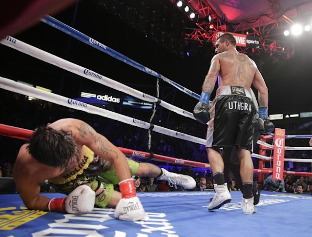 Lucas Matthysse, right, of Argentina, walks to his corner after he knocked down John Molina Jr. during the 11th round of a junior welterweight boxing match Saturday, April 26, 2014, in Carson, Calif. Matthysse won by knockout in the 11th round. (AP Photo/Jae C. Hong)