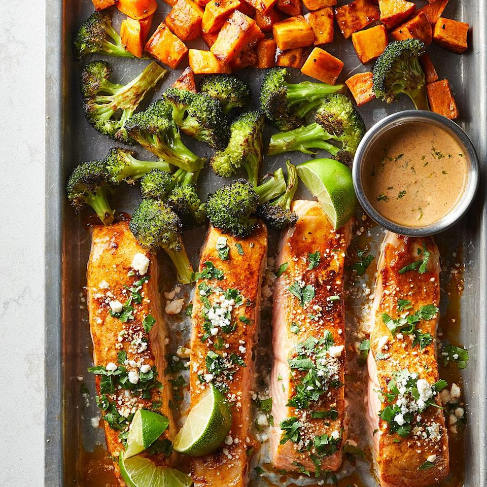 "<p>The vibrant combo of cheese, cilantro, chili, and lime--inspired by Mexican street corn--makes this salmon sheet-pan dinner burst with flavor. <a href=""http://www.eatingwell.com/recipe/281181/sheet-pan-salmon-with-sweet-potatoes-broccoli/"" rel=""nofollow noopener"" target=""_blank"" data-ylk=""slk:View recipe"" class=""link rapid-noclick-resp""> View recipe </a></p>"