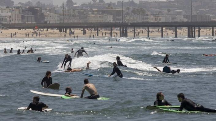 These surfers enjoyed the waves at Venice Beach in Los Angeles
