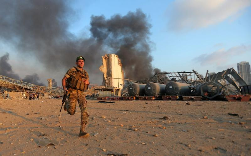 A Lebanese soldier at the scene of the explosion - STR/AFP